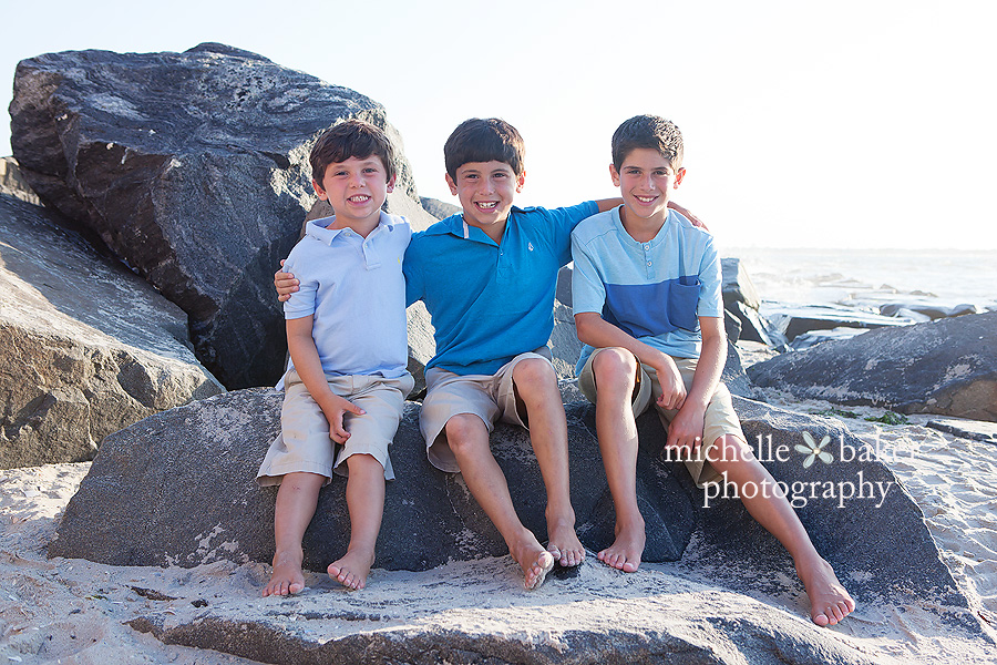 3 sibling boys on beach