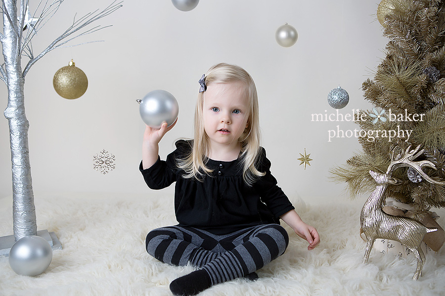 Little girl in holiday set with Christmas decorations