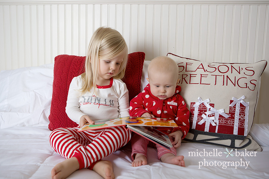 2 sisters reading on a bed in Holiday PJ